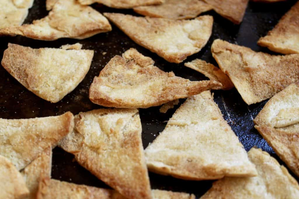 Baked pita chips on tray