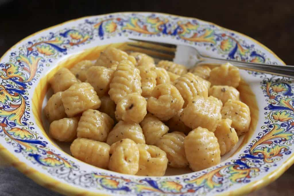 Potato pumpkin gnocchi in a bowl.