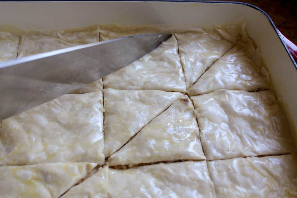 cutting raw baklava