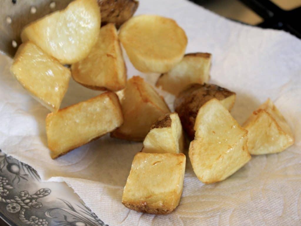Frying potatoes for Patatas Bravas