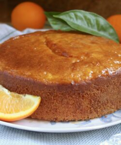 Sicilian Whole Orange cake on a plate with oranges