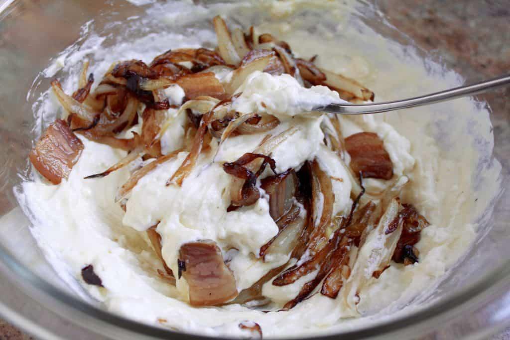 Making caramelized onion, feta and pancetta tart