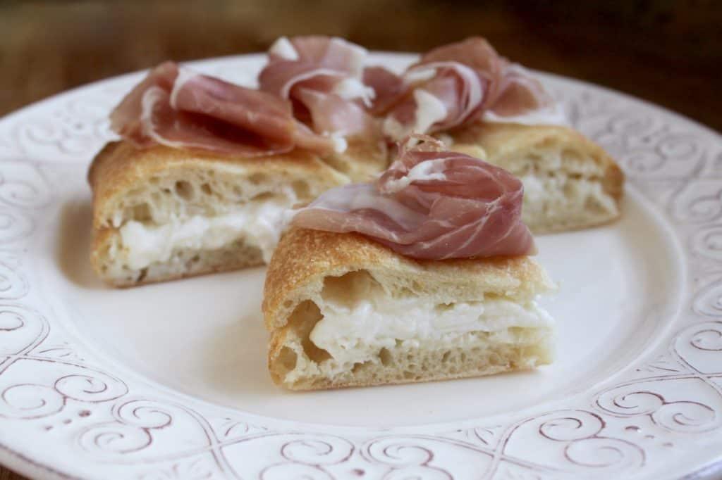 Focaccia with burrata and prosciutto