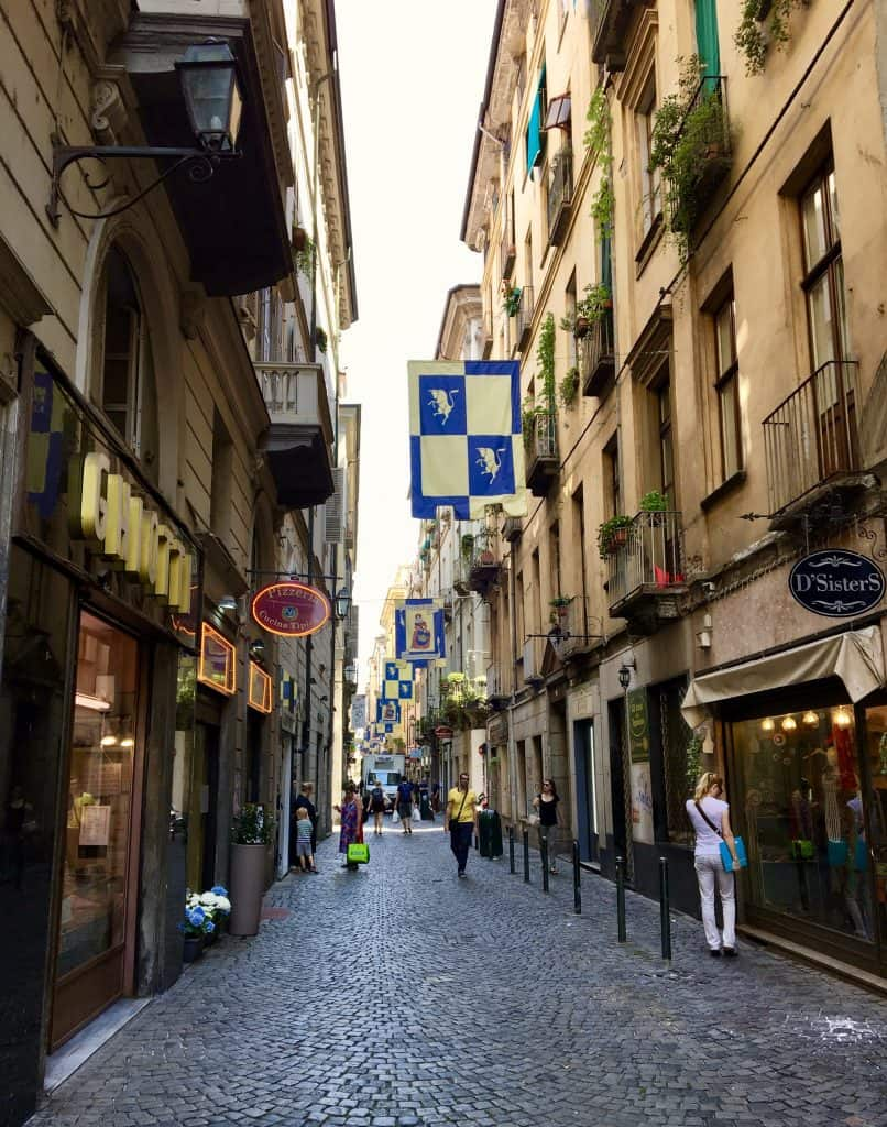 turin torino cobblestone street shopping tourism