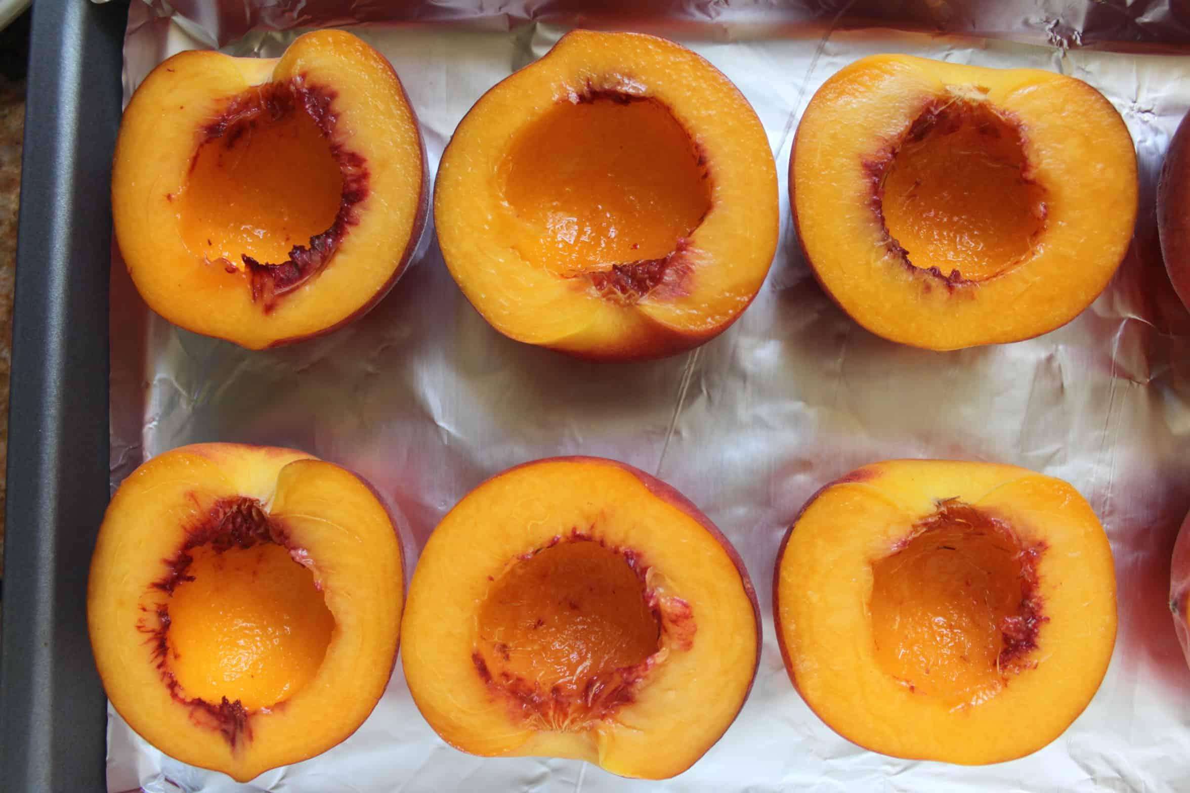 peach halves on a tray
