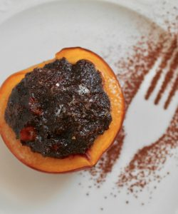 Italian style baked peaches filled with cocoa and biscuits
