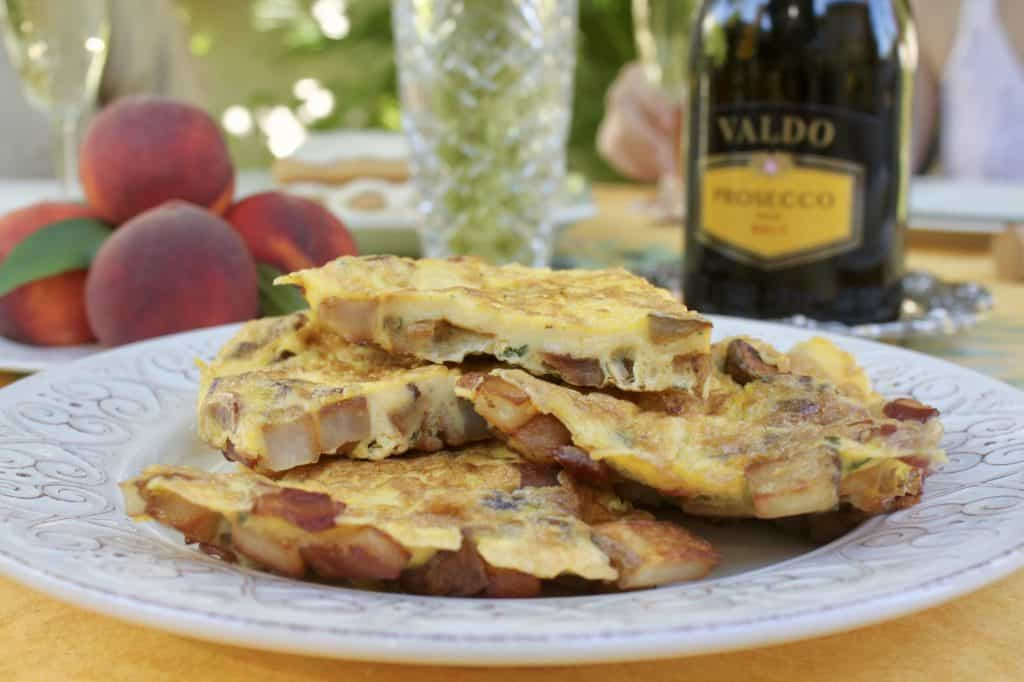 Frittata on brunch table with Valdo Prosecco