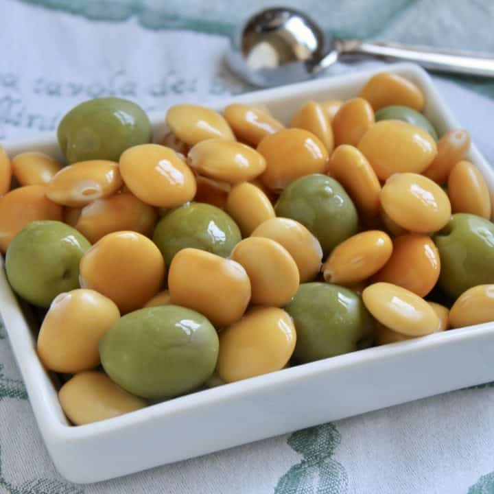 Lupini beans and green olives in a rectangular dish