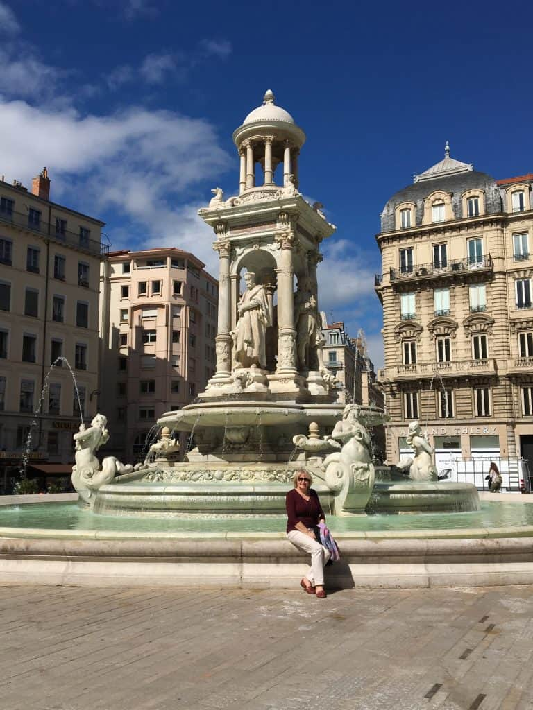 My mother at a fountain in Lyon