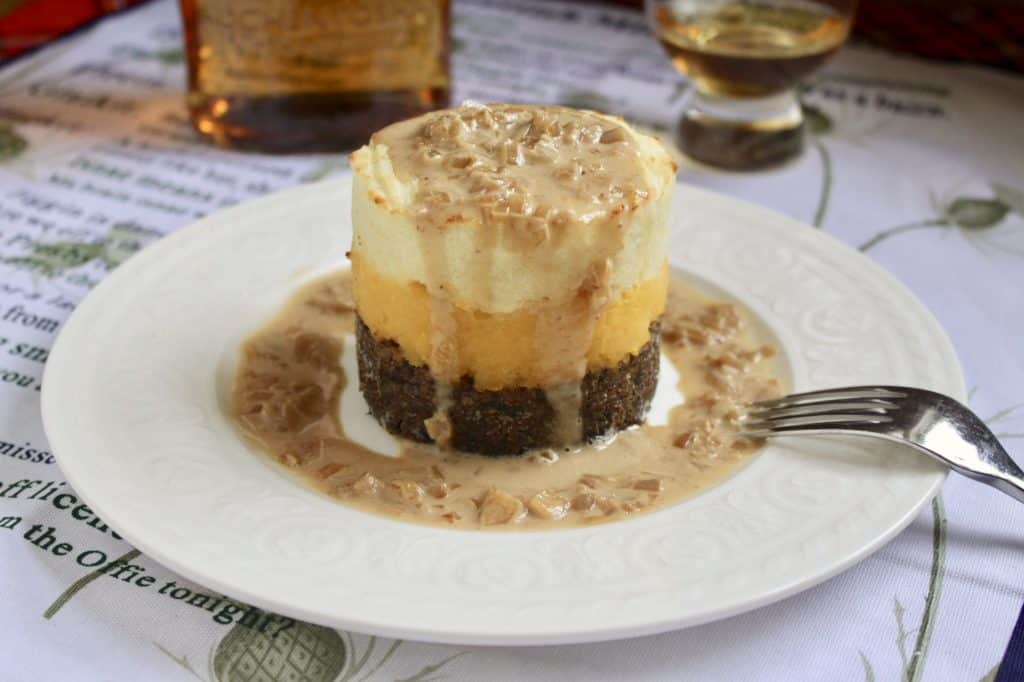 Haggis neeps and tatties stack tower with whisky sauce photo