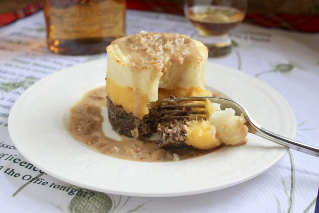 Haggis neeps and tatties stack tower with whisky sauce for a Burns Night menu