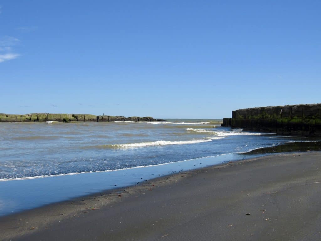 Black sand beach in Patea, New Zealand