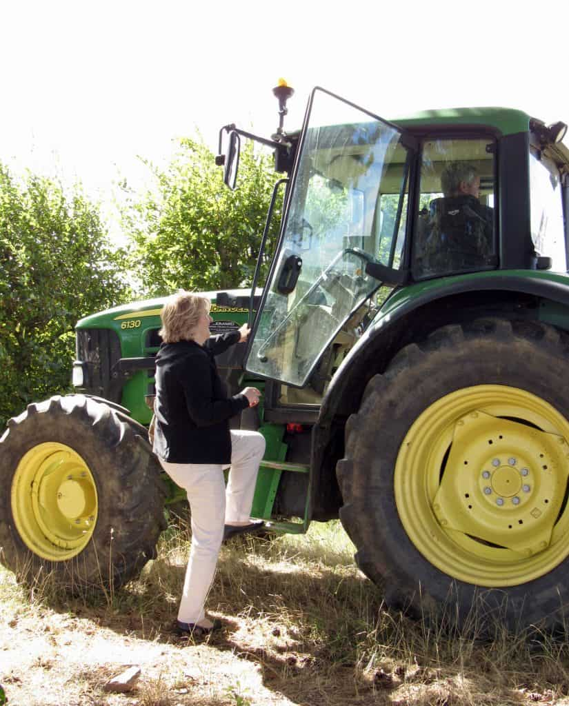 Mum getting into a tractor in France