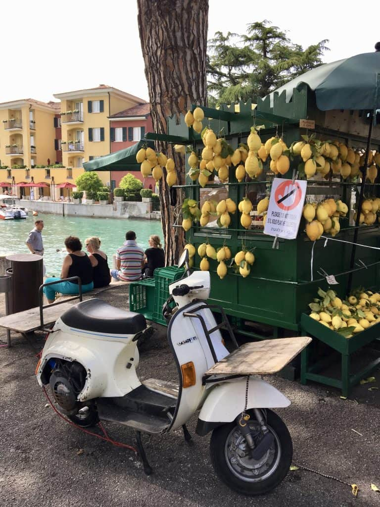 Vespa and a lemonade stand in Sirmione, Lake Garda (visiting Sirmione by car)