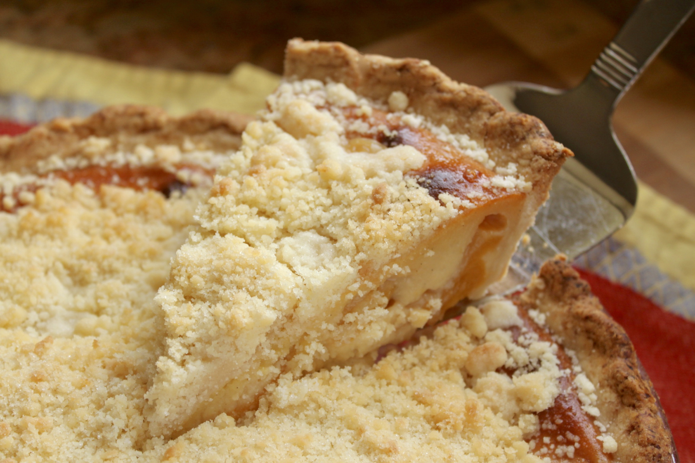 serving a slice of custard peach pie