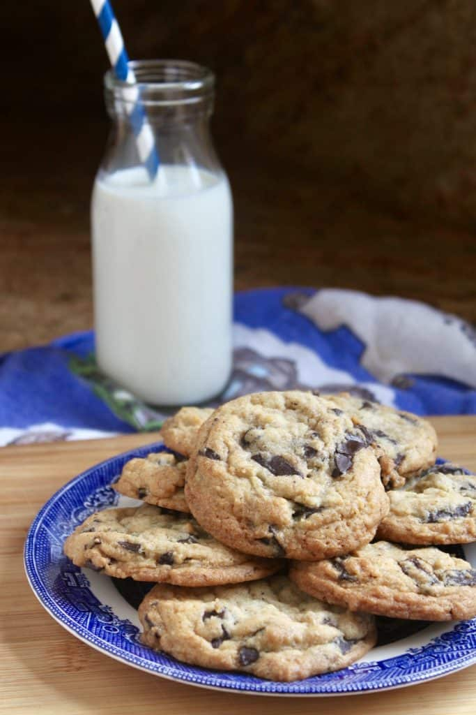 always perfect chocolate chunk cookies on a plate with milk