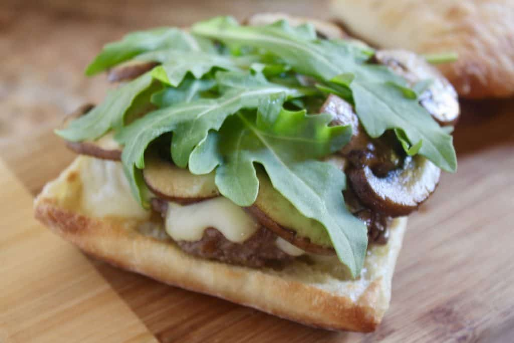 arugula topped brie and truffle burger