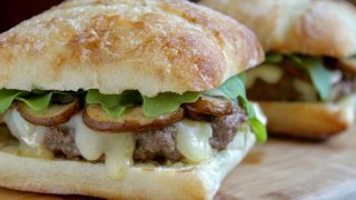 Brie and Truffle Burger with Mushrooms, Arugula and Crème Fraîche