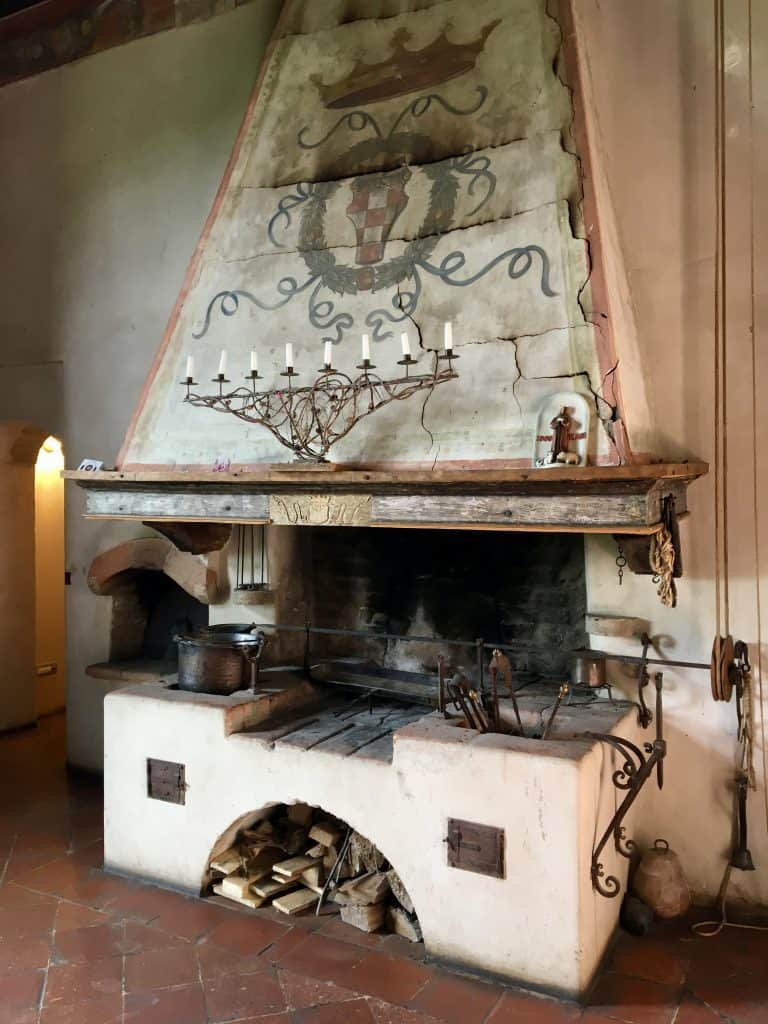 Fireplace in the lobby of Antica Corte Pallavicina