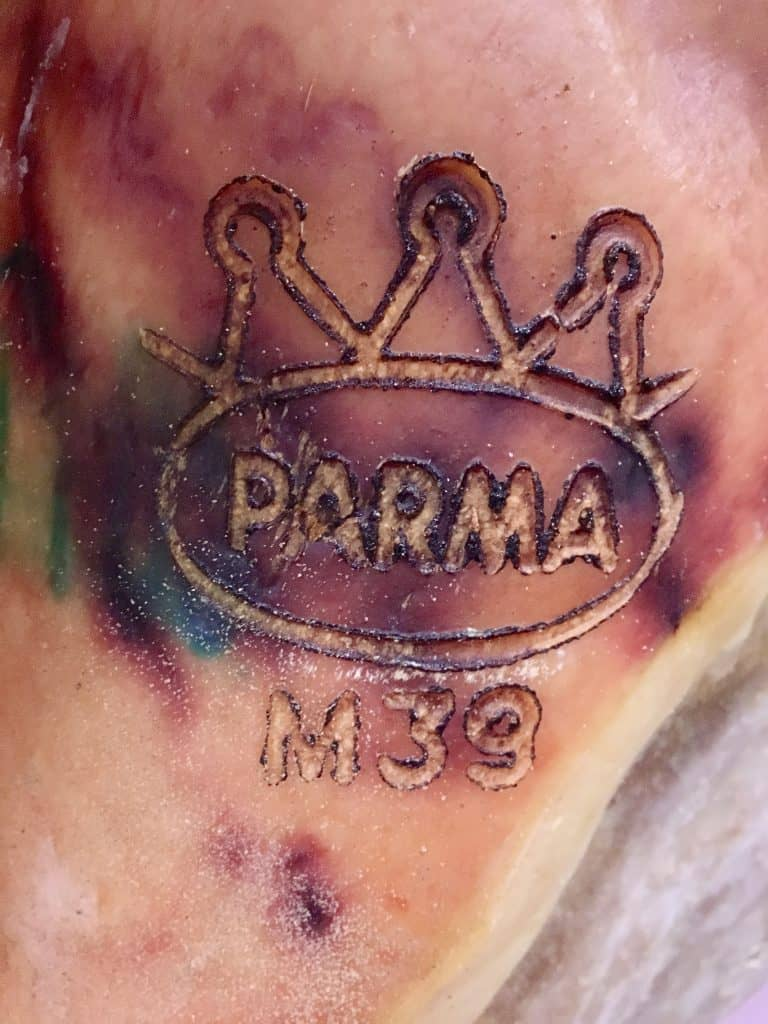 Parma logo on a prosciutto