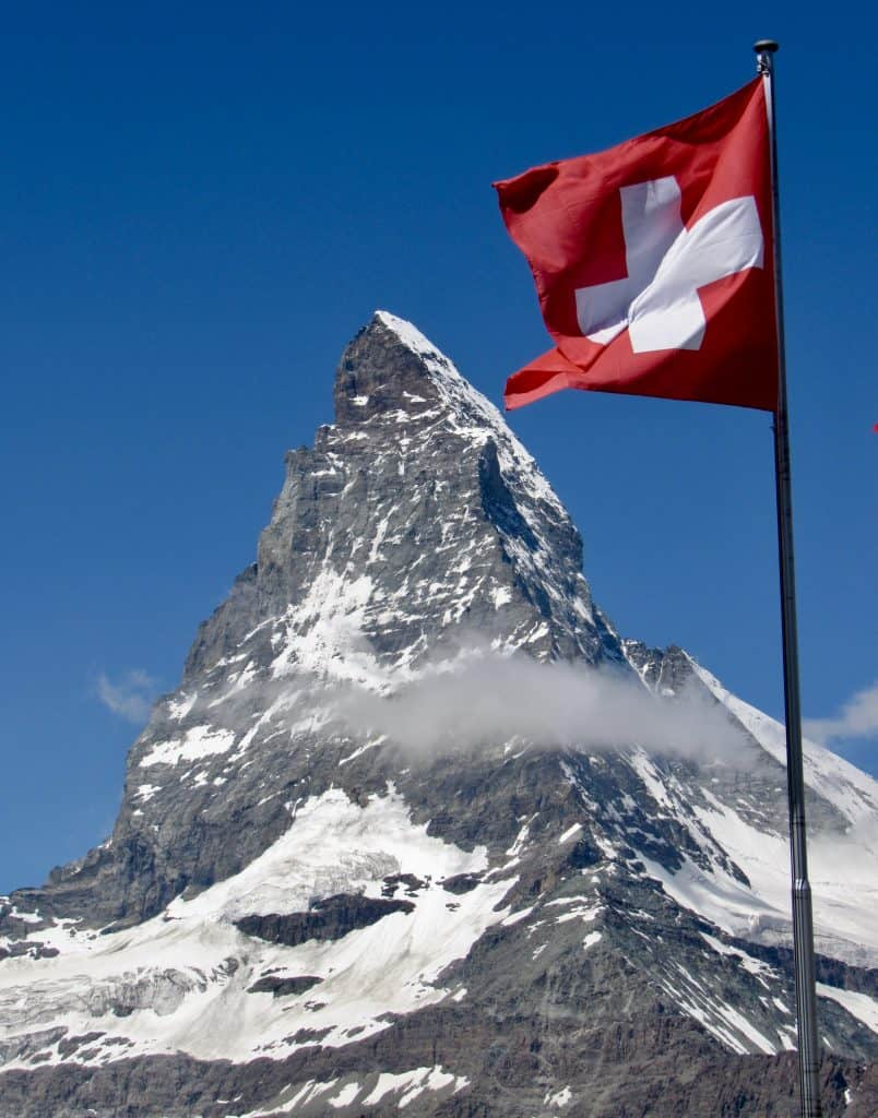 Swiss flag in front of the Matterhorn