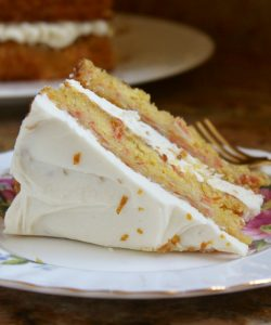 slice of pumpkin cake with Best orange cream cheese frosting
