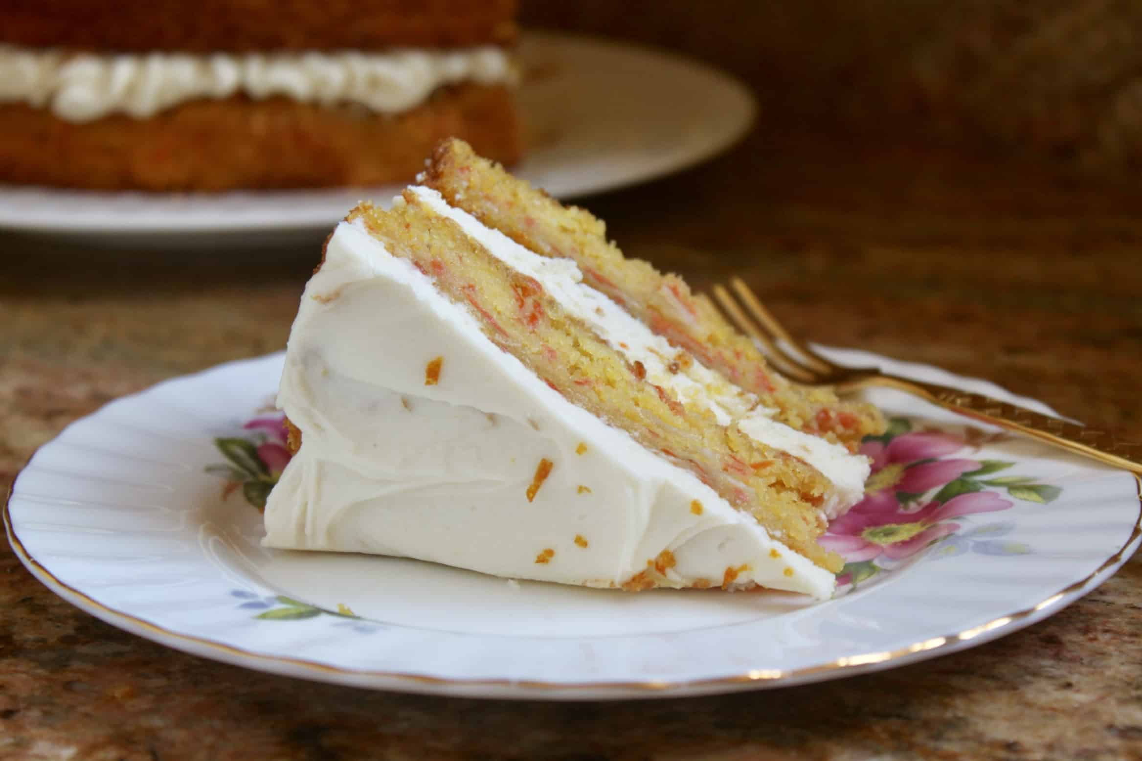 slice of pumpkin carrot cake with Best orange cream cheese frosting