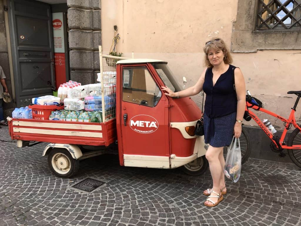 Christina with her favorite Piaggio ape truck