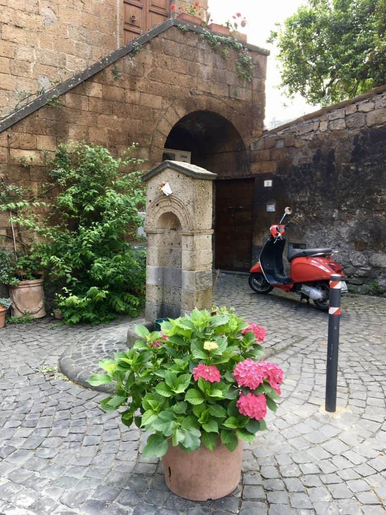 flowers and a vespa in Orvieto, Italy