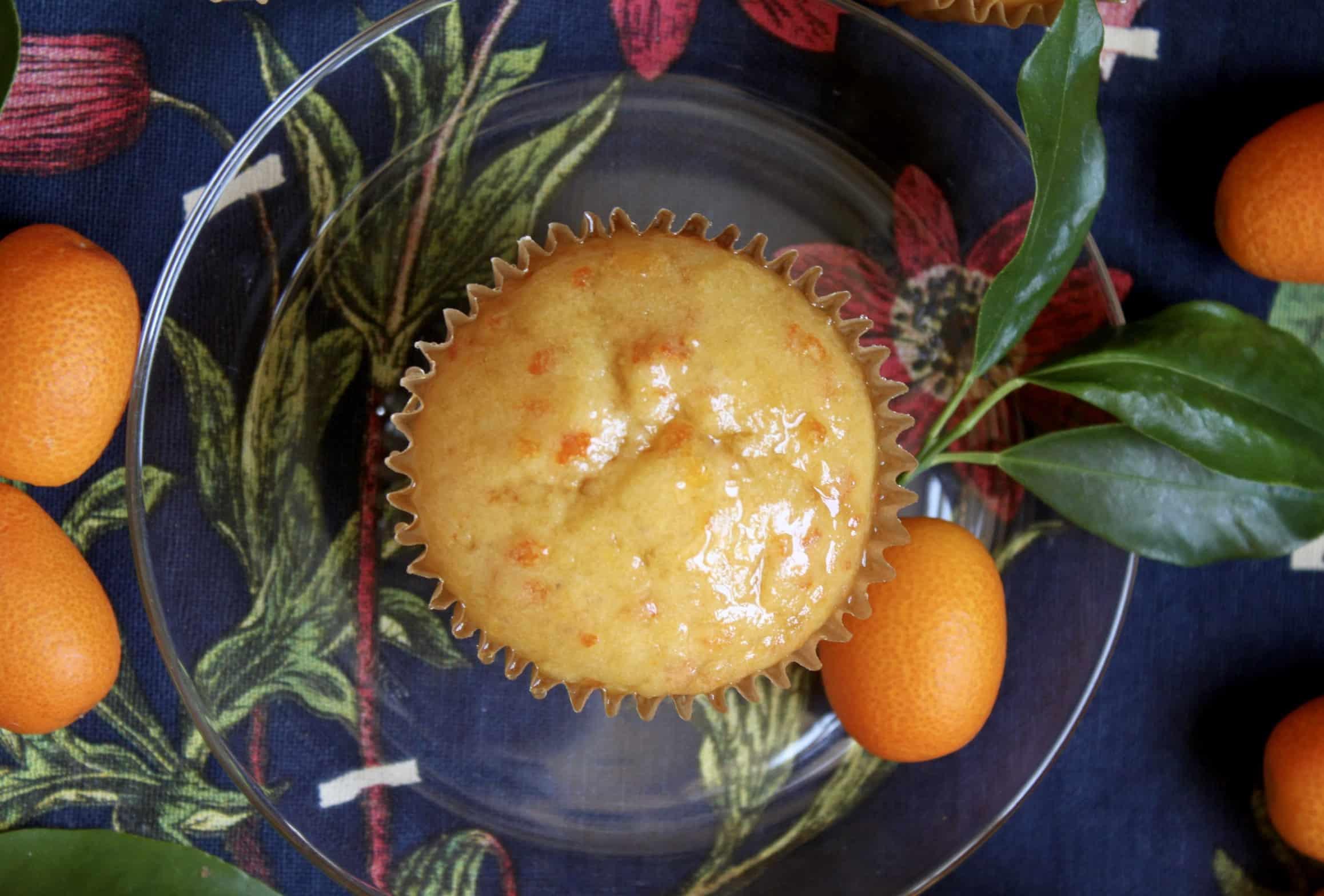 single kumquat cupcake on a clear plate