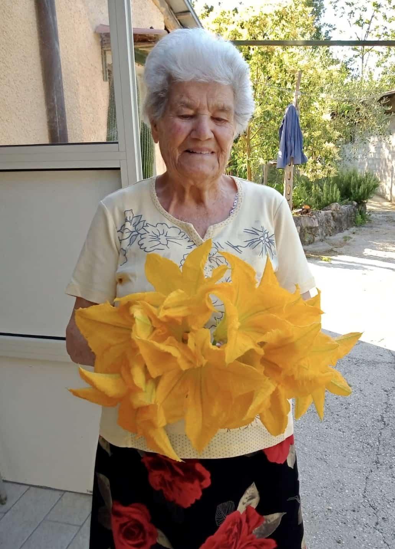 Zia Iolanda with zucchini blossoms