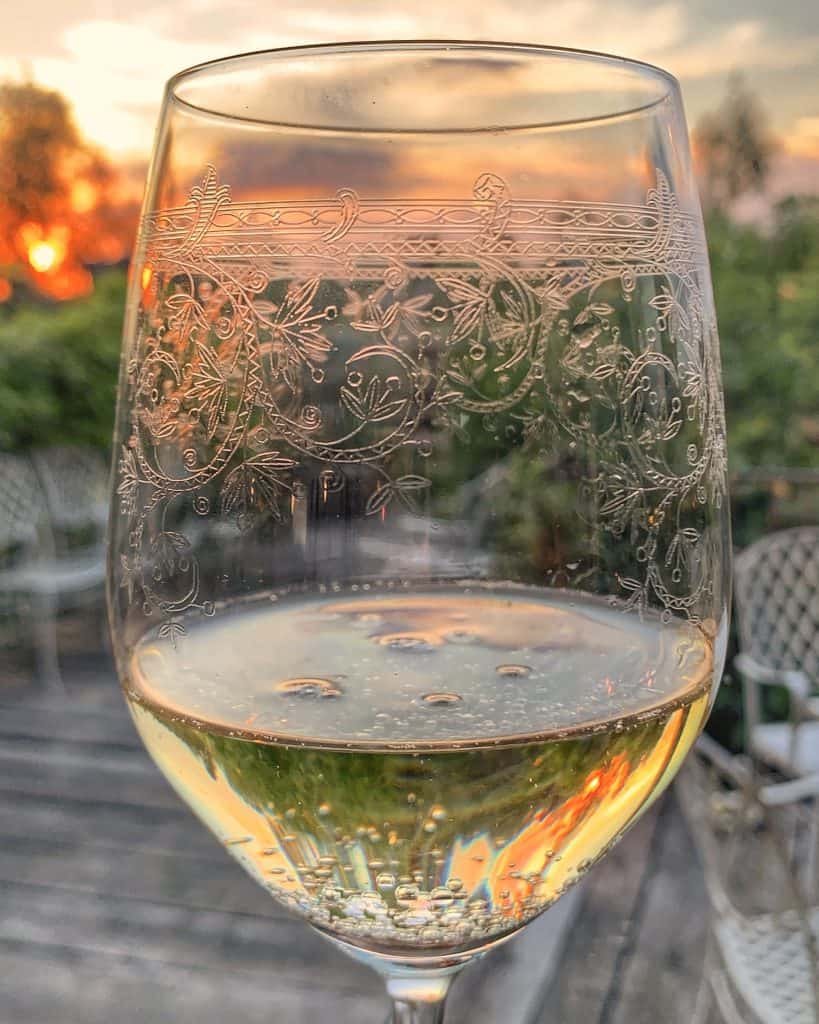 glass of wine at sunset at Antica Corte Pallavicina