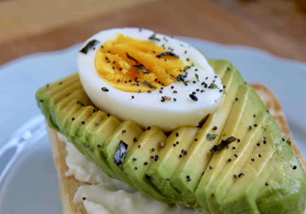 avocado toast with burrata and egg