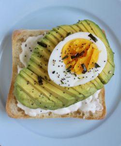 avocado toast with burrata and egg