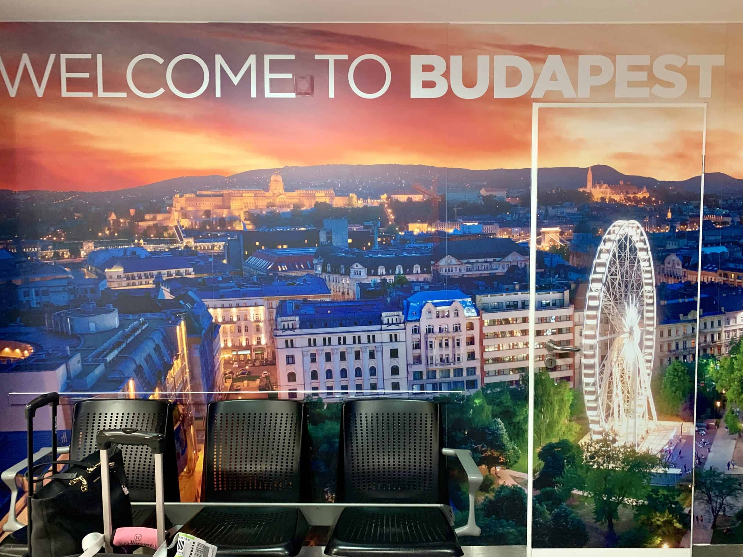 welcome to budapest sign at airport