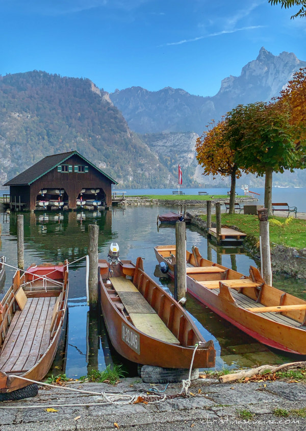 boats in the water in the Austrian Lake District by Christina Conte