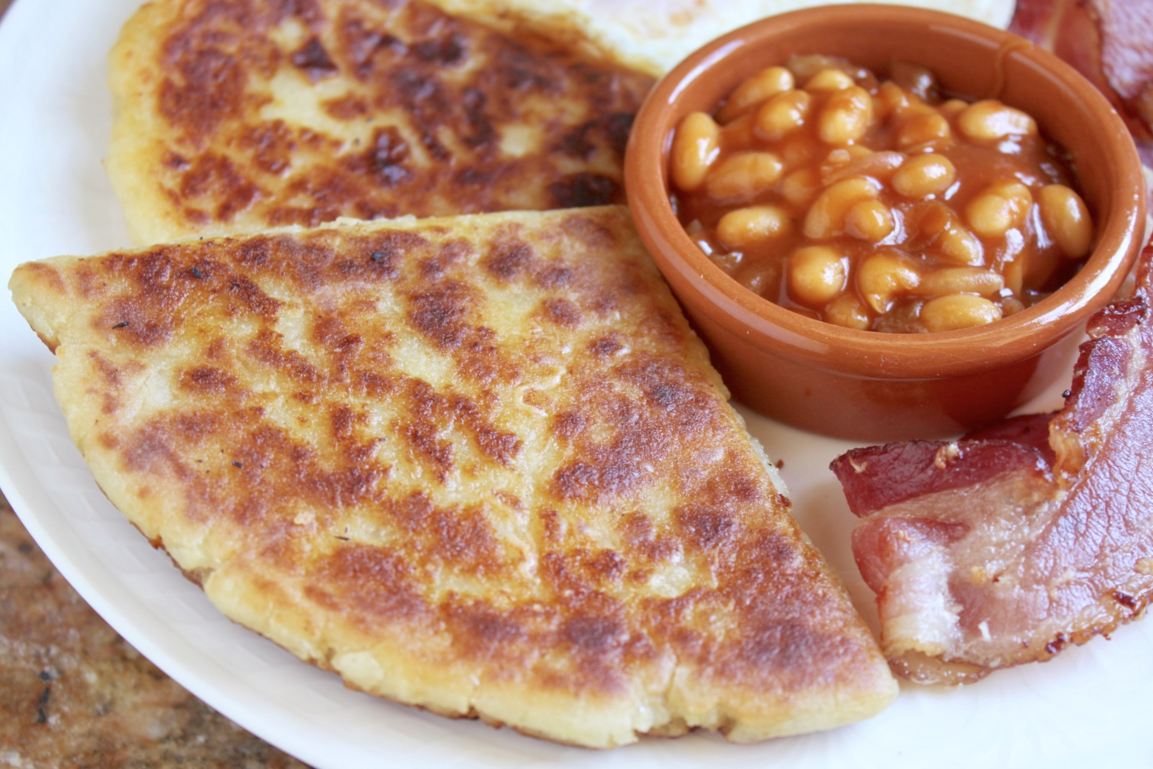 potato bread on plate with beans