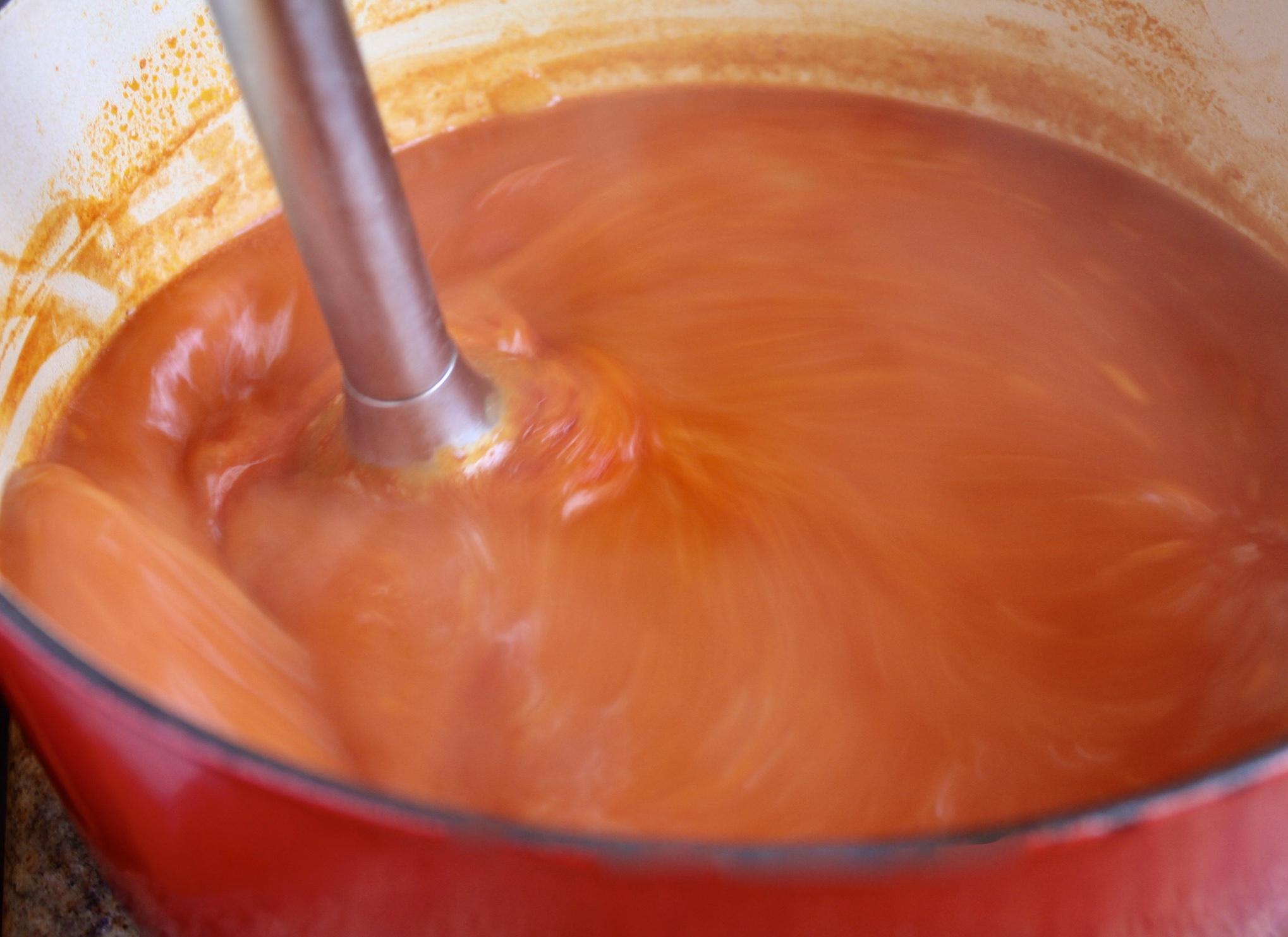 blending soup in a pot