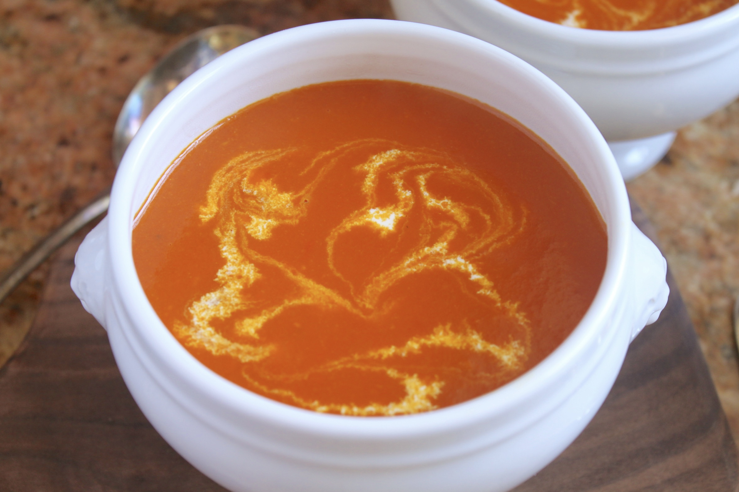 tomato turmeric soup in a bowl