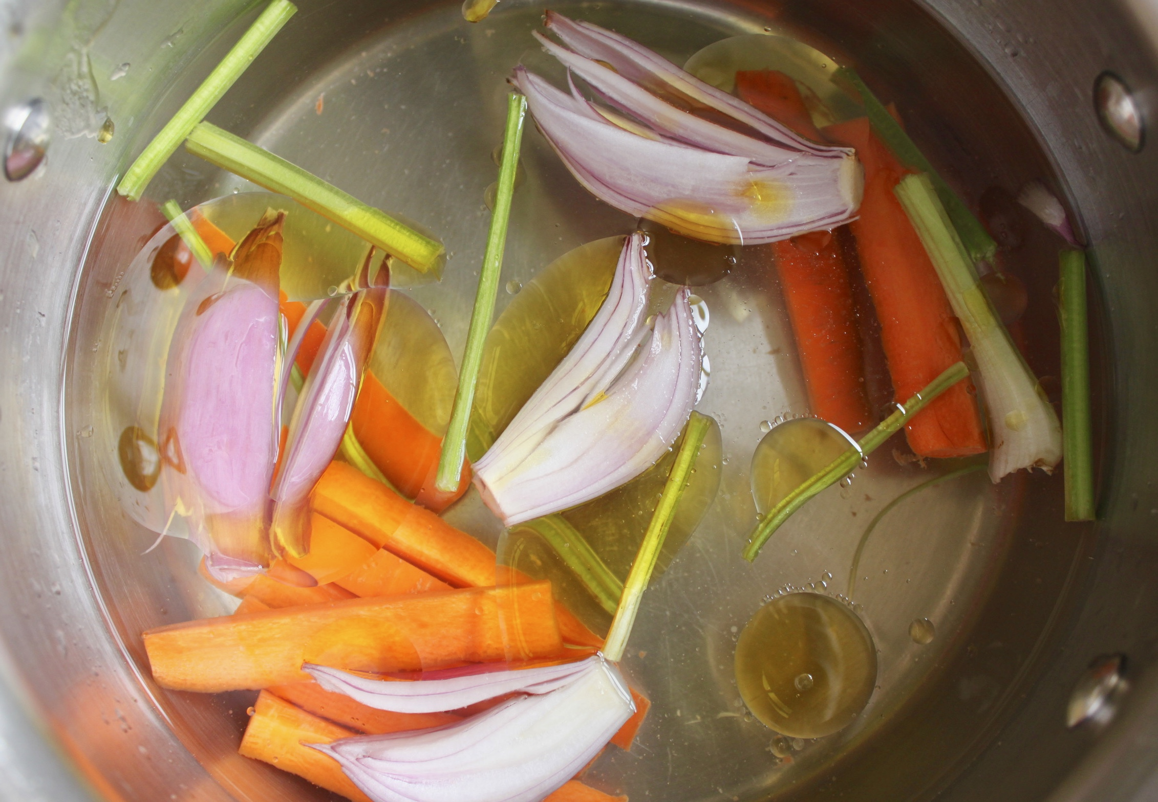 vegetables in the pot with water and oil