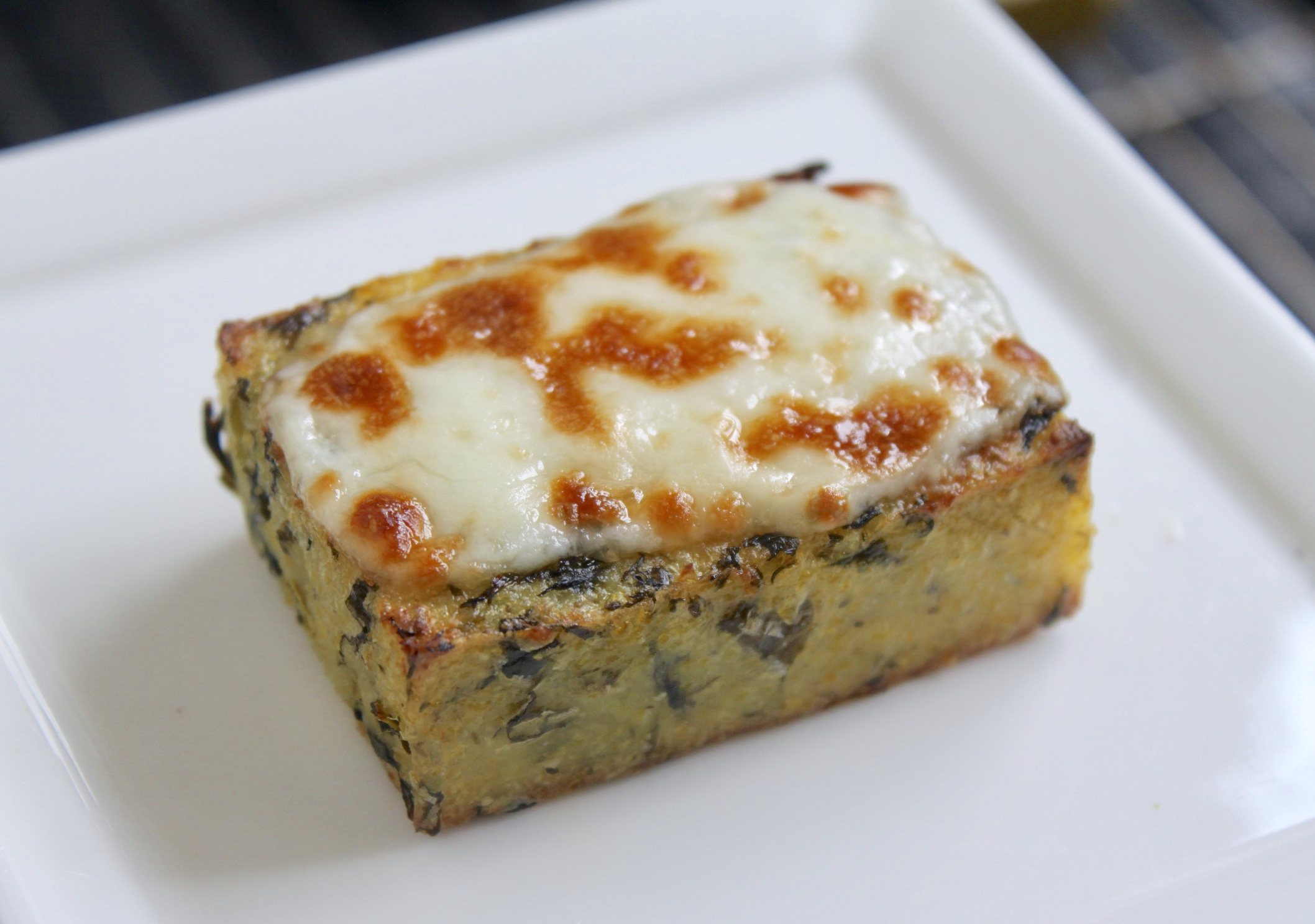 Piece of grilled polenta with cheese