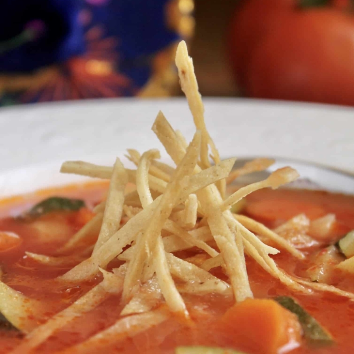 tortilla soup with crunchy tortilla strips in bowl