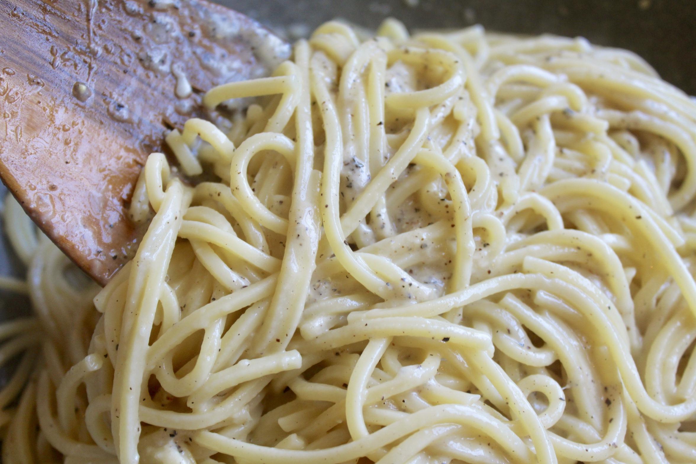 stirring the pasta