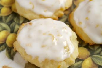 lemon ricotta cookies on a lemon plate