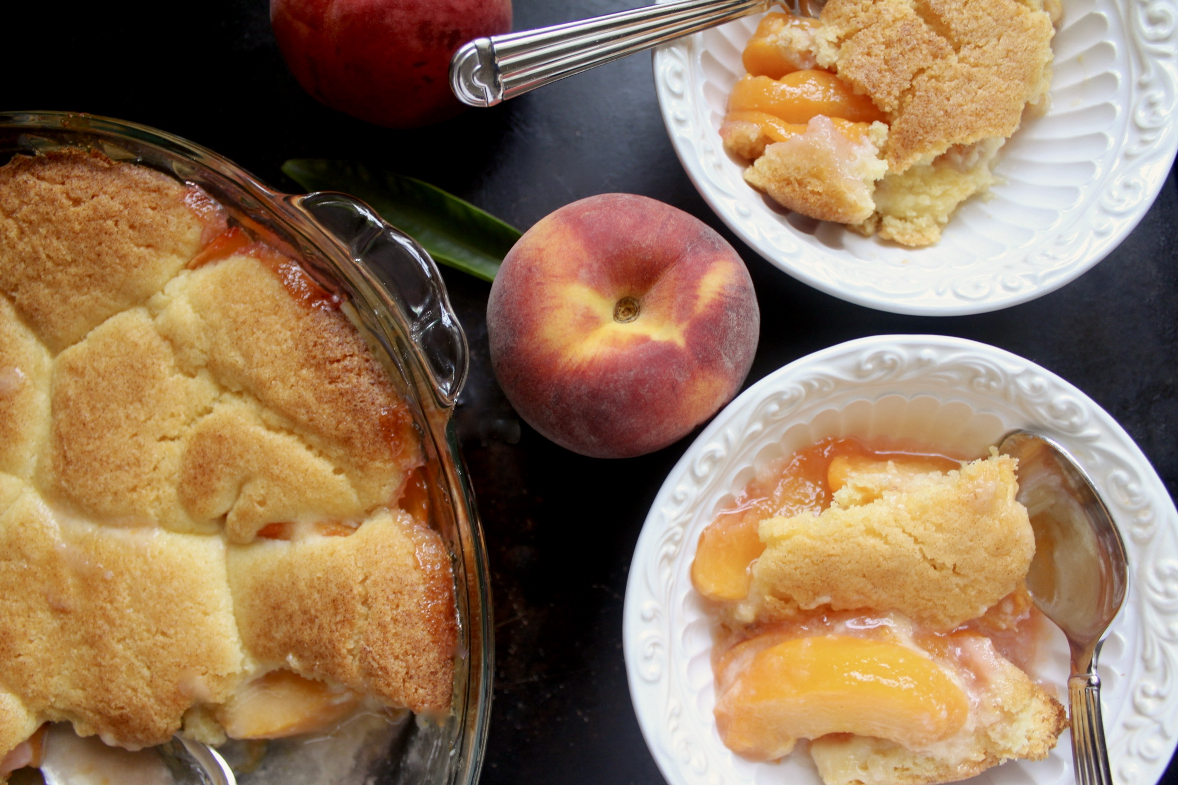 overhead peach cobbler in bowl with peach