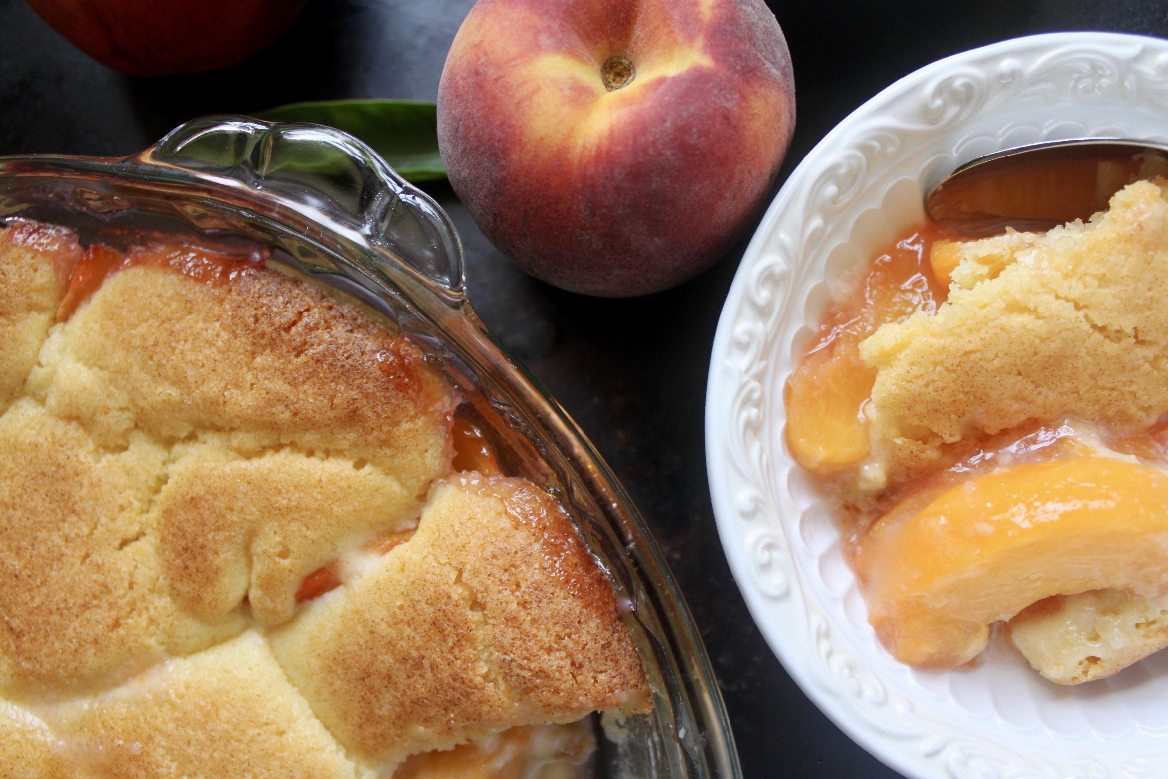overhead peach cobbler in bowl with peach