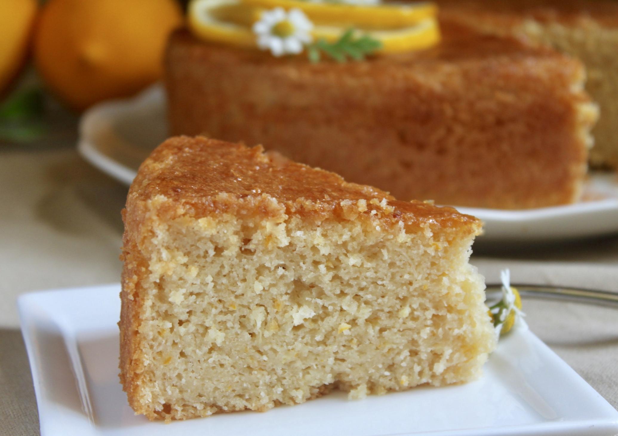 slice of gluten free lemon cake on a plate