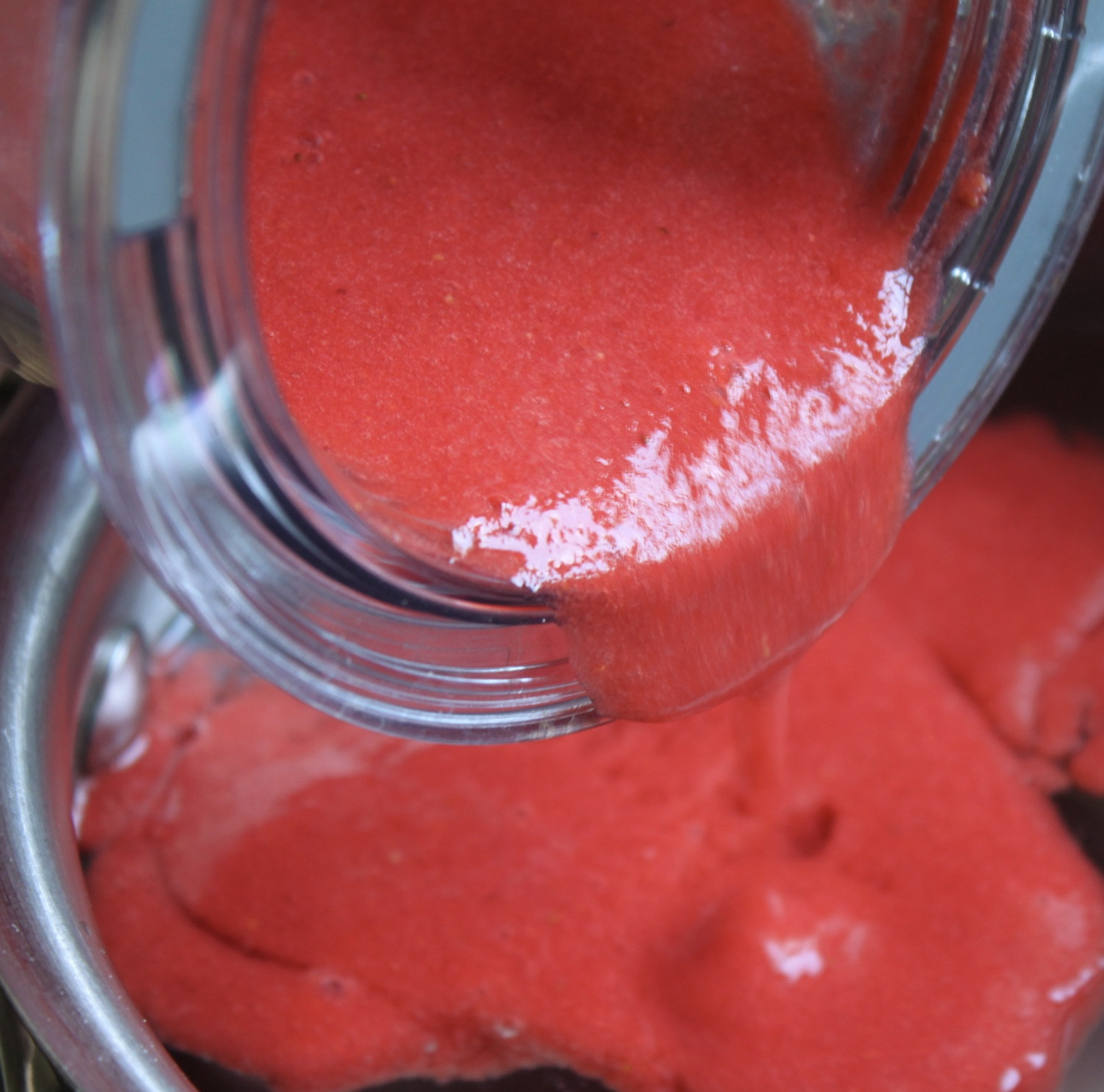 pouring strawberry puree into pot