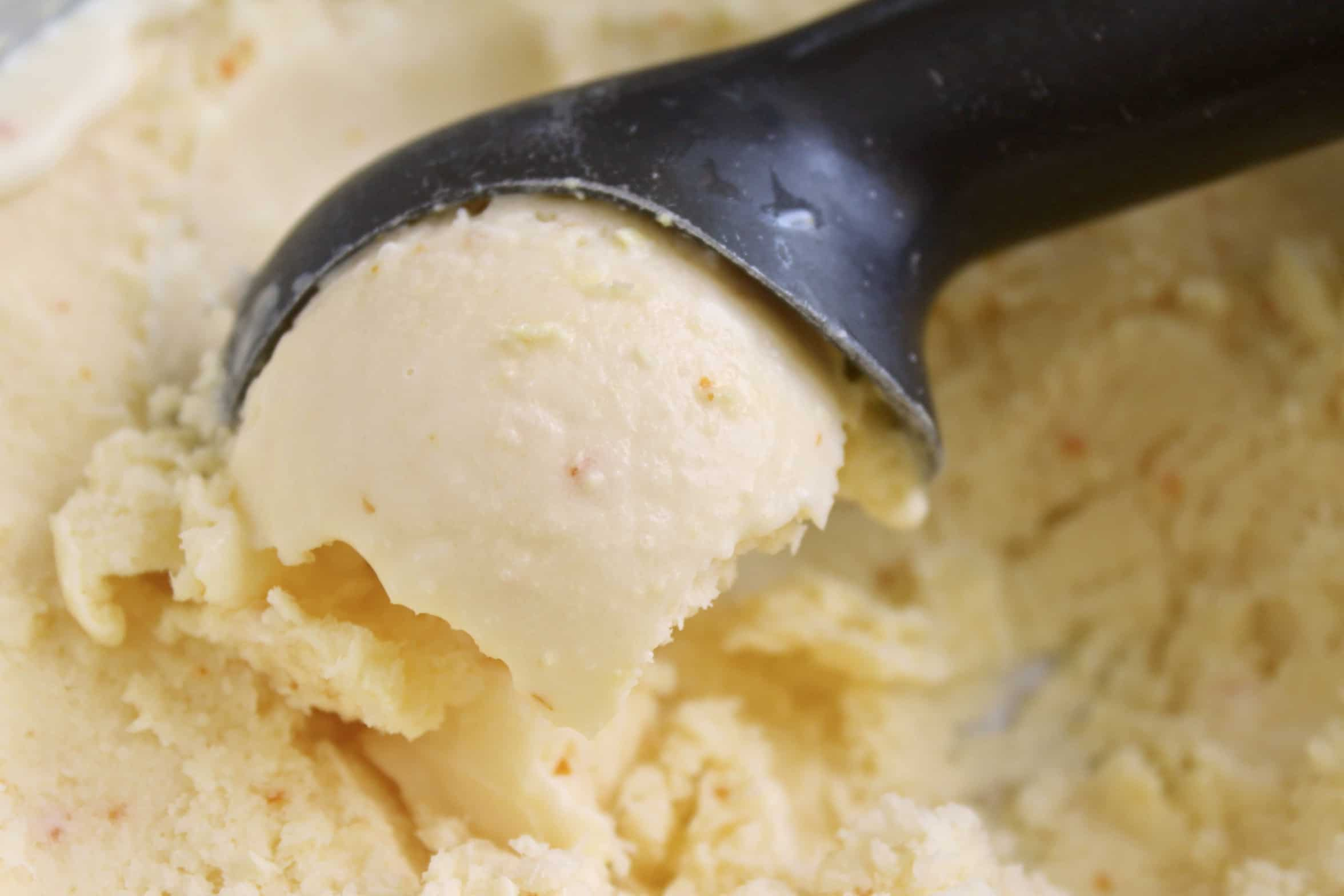 using an ice cream scoop to serve ice cream