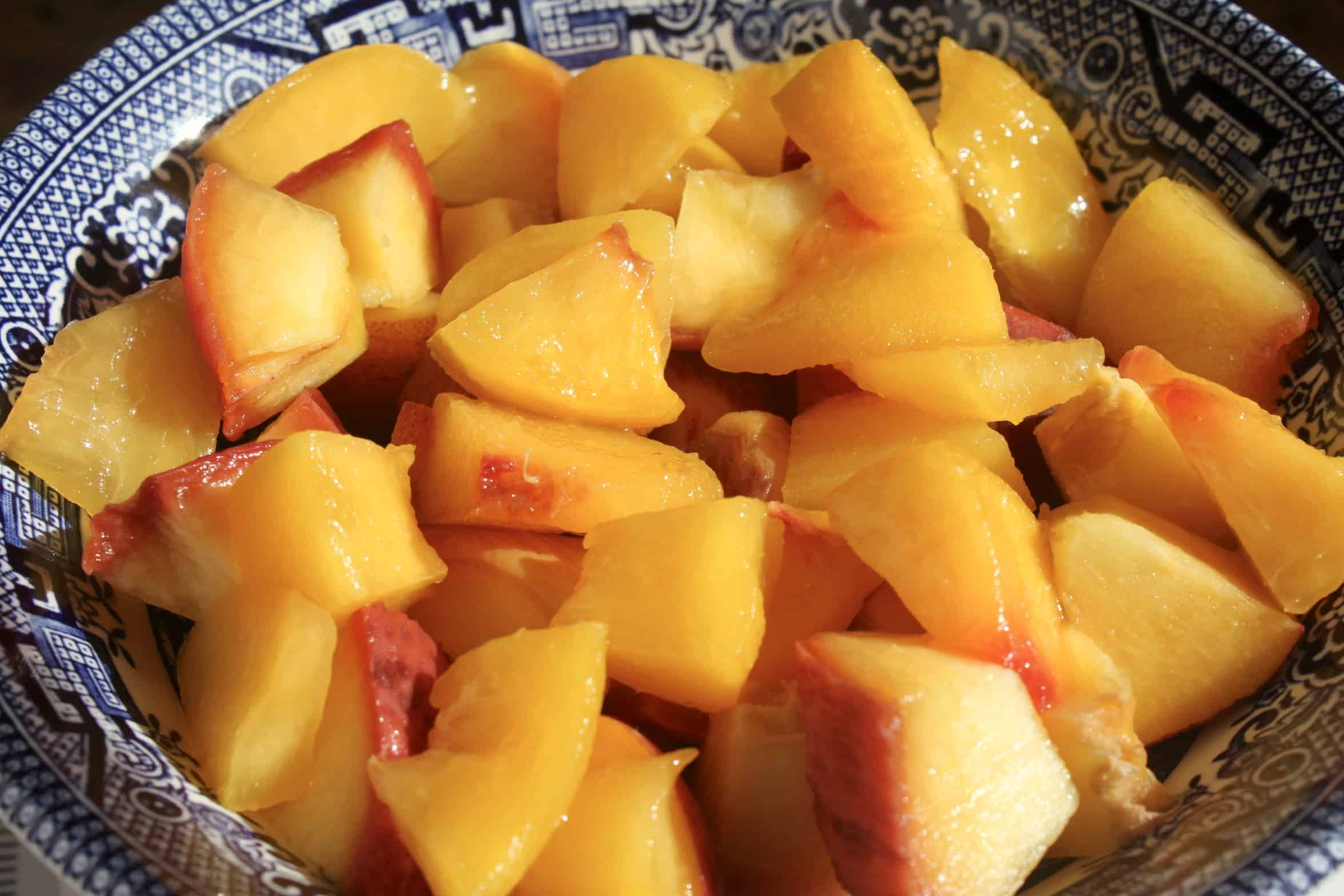 fresh cut peaches in a bowl
